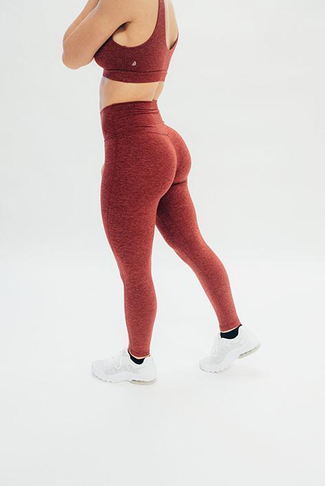 post pregnancy woman wearing exercise leggings
